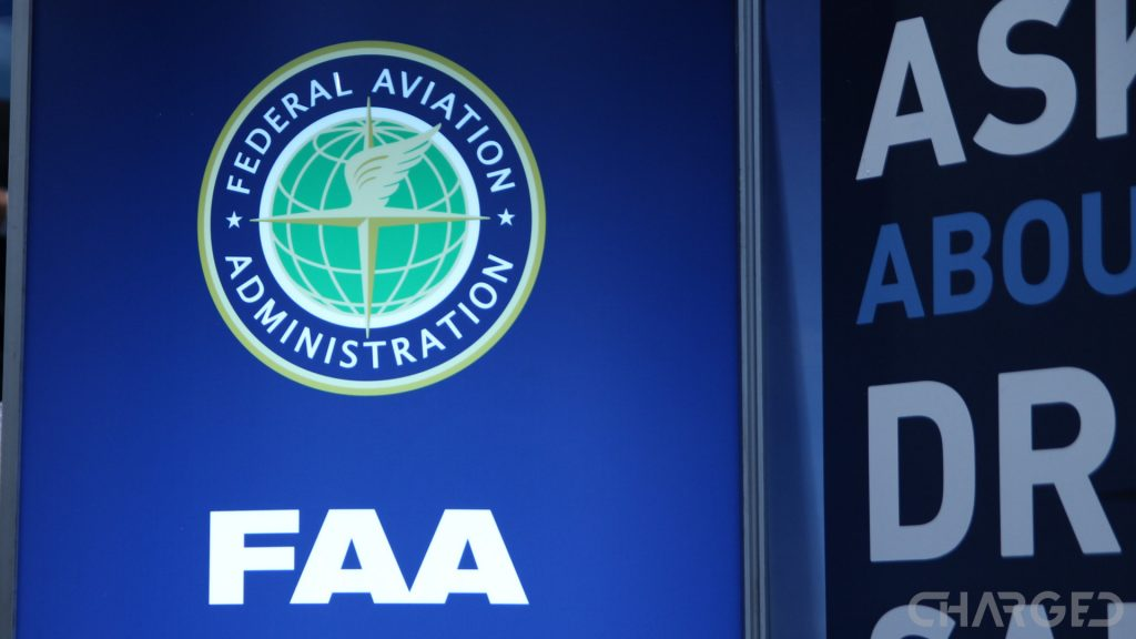 Image of the FAA logo on their booth at CES 2017, the words ask about drone registration are partially visible.