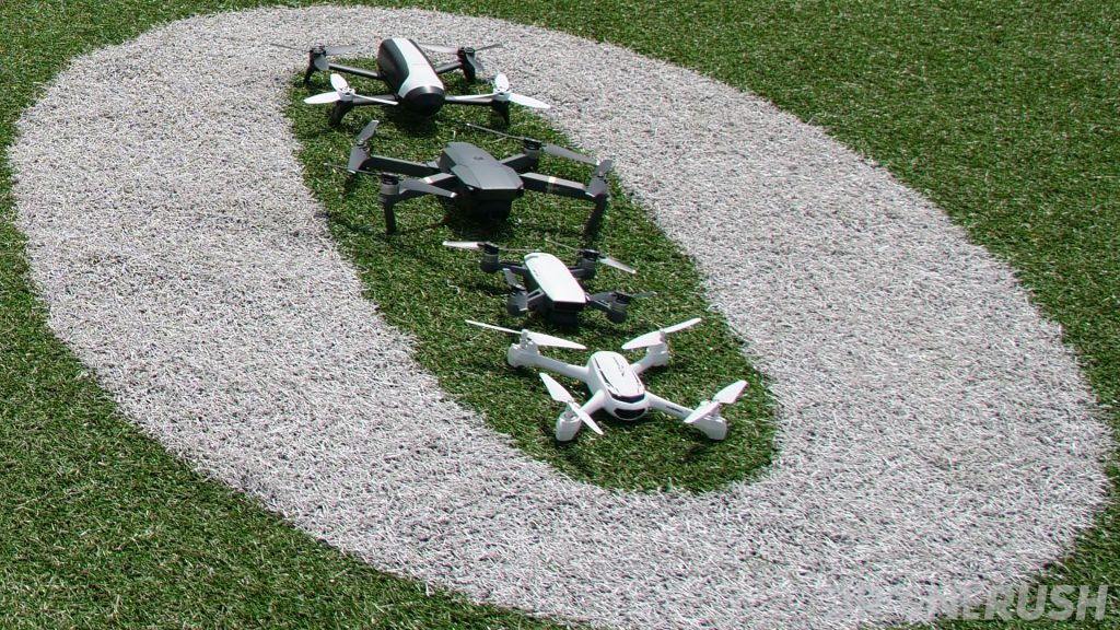 As an example of some of the best drone manufacturers, drone companies, around, sitting in the middle of a football field is the DJI Mavic Pro, DJI Spark, Hubsan H501s and Parrot Bebop 2.