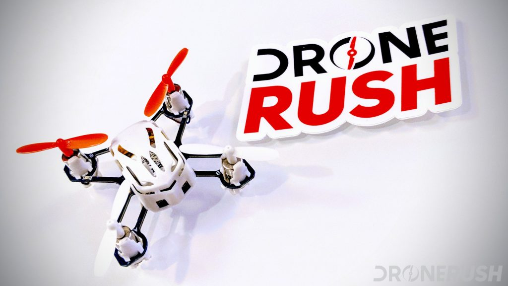 Drone Rush colored Hubsan H111 nano drone on white table with Drone Rush logo sticker