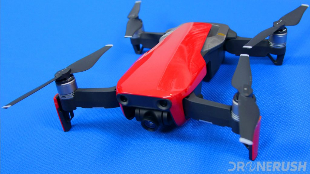 A red DJI Mavic Air sits on a table with a blue drop cloth, this photo is from our DJI Mavic Air review, and is an example of one of the best drones under 1000, alternatively titled best drones under $1000.